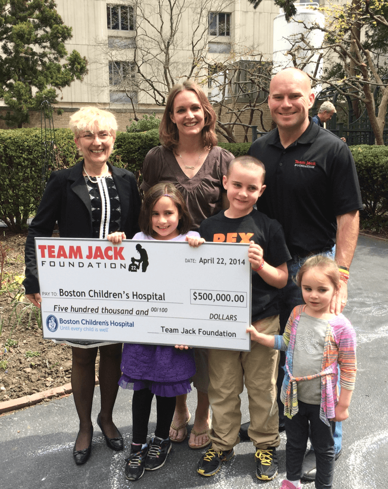 Hoffman family presenting check